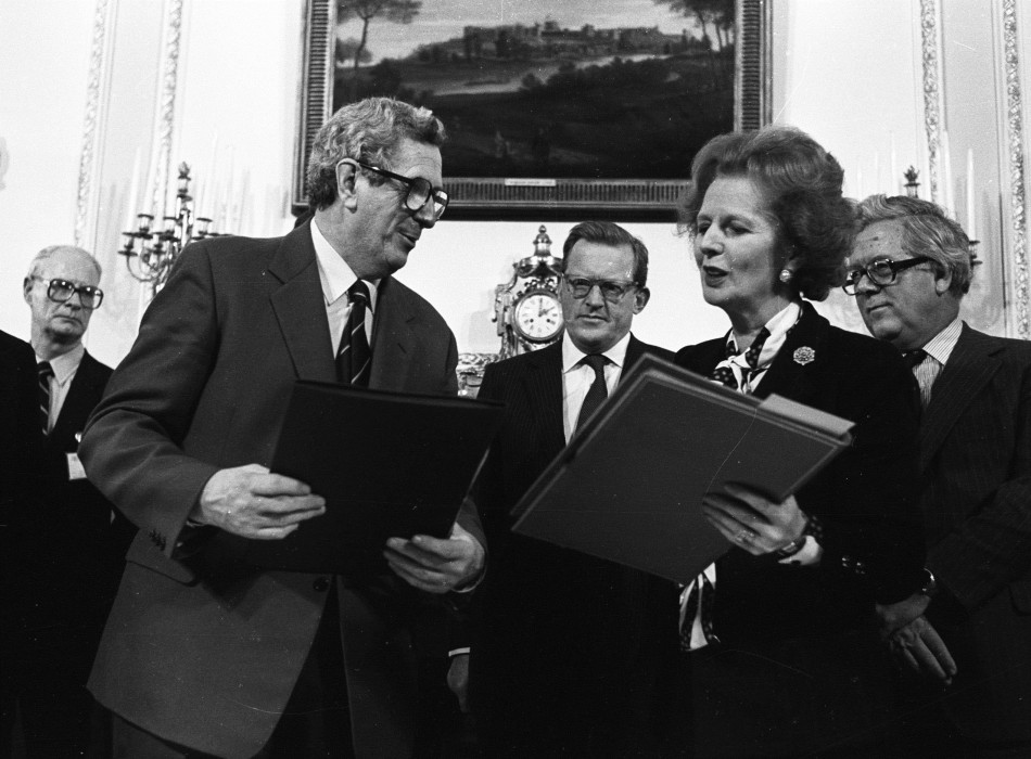 Irish PM Fitzgerald and British PM Thatcher exchange documents after signing Anglo-Irish agreement at Hillsborough House on November 15, 1985