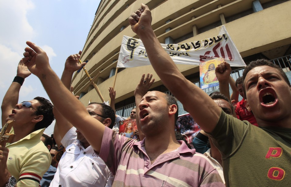 """<="""""""" a="""""""" border=""""0""""> Add to cart   Add to lightbox (U2 Mexico) Download layout (Watermarked) Egyptian Christians chant slogans as they protest against recent attacks in front of the state television building in Cairo"""