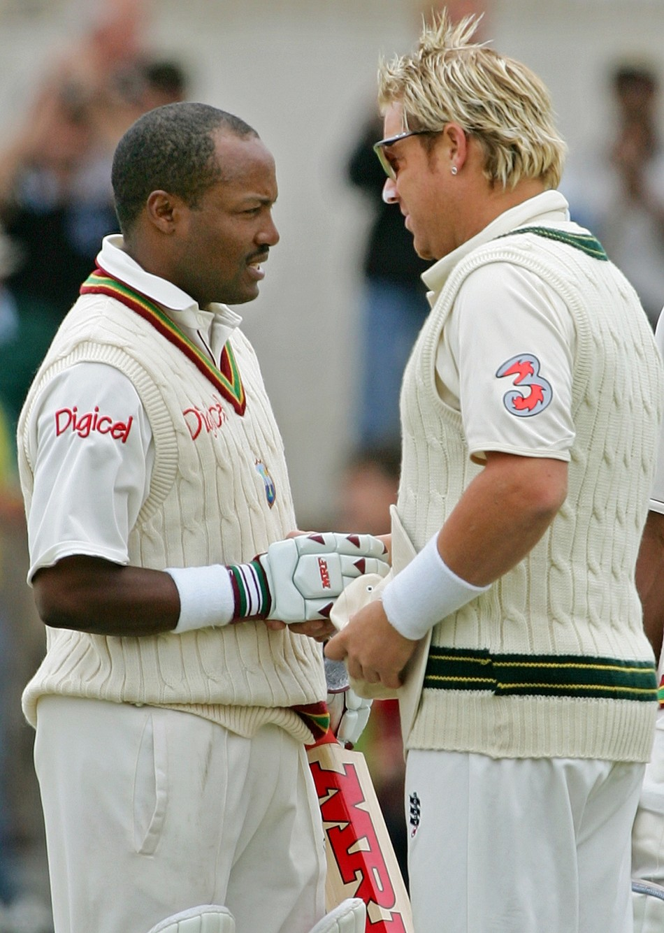 Warne congratulates West Indies' Brian Lara. Warne is the game's second most prolific wicket taker.
