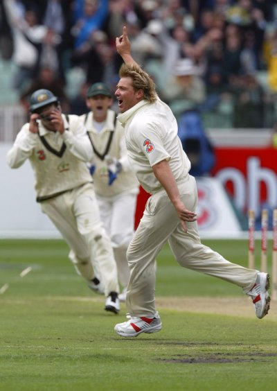 Warne wheels away becoming the first bowler to reach 700 wickets during the first day of the fourth Ashes cricket test between Australia and England at the Melbourne Cricket Ground December 26, 2006.