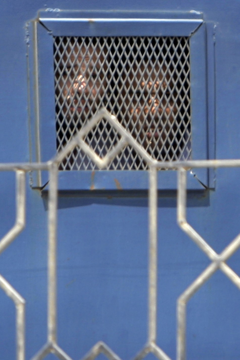 Unidentified suspects look on from inside a vehicle as they they leave the Emergency State Security Court in New Cairo