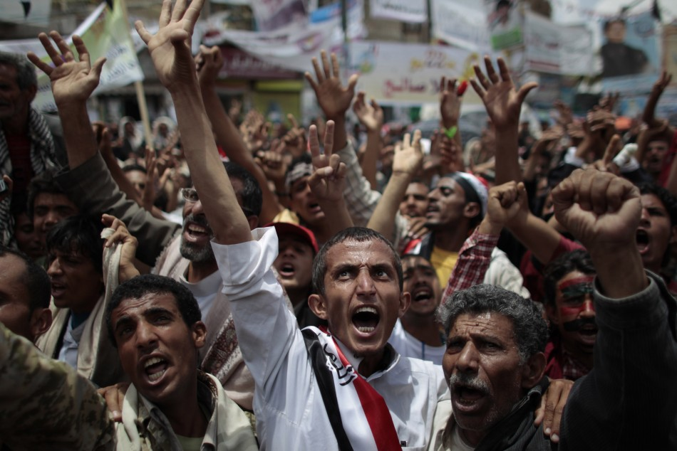 Anti-government protesters shout during a rally to demand the ouster of Yemen's President Saleh in Sanaa