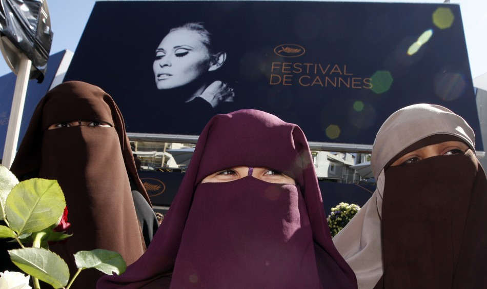 Three women wearing the niqab