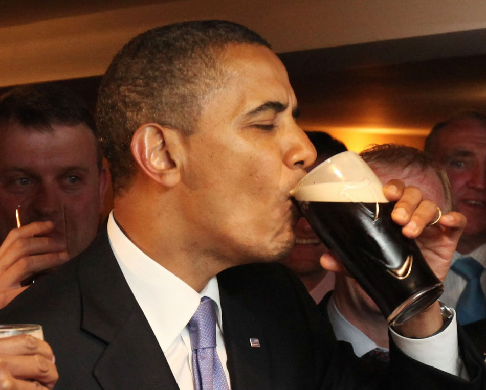 U.S. President Barack Obama drinks from a pint of Guinness stout at the Ollie Hayes pub in Moneygall