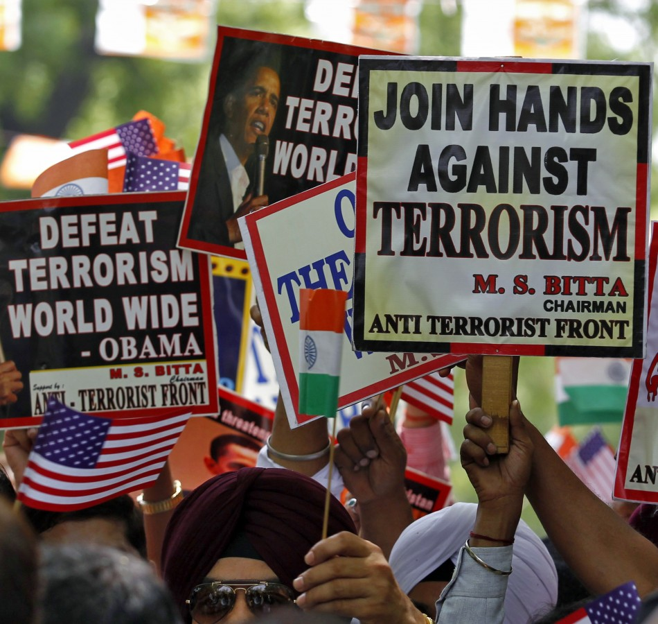 Members of AIATF hold placards in New Delhi