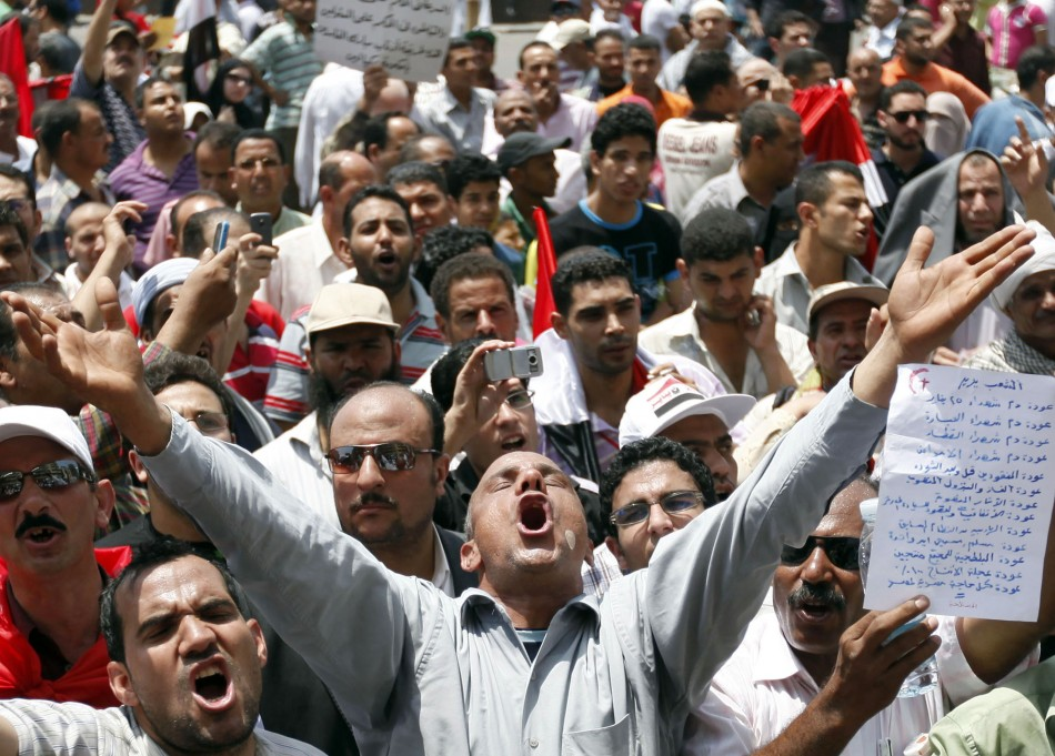 A man gestures during a demonstration in Tahrir Square in Cairo
