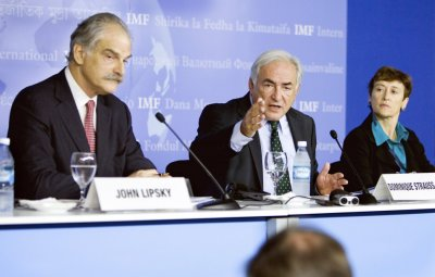 Strauss-Kahn, Lipski and Atkinson answer questions during a news conference at the Istanbul Congress Center