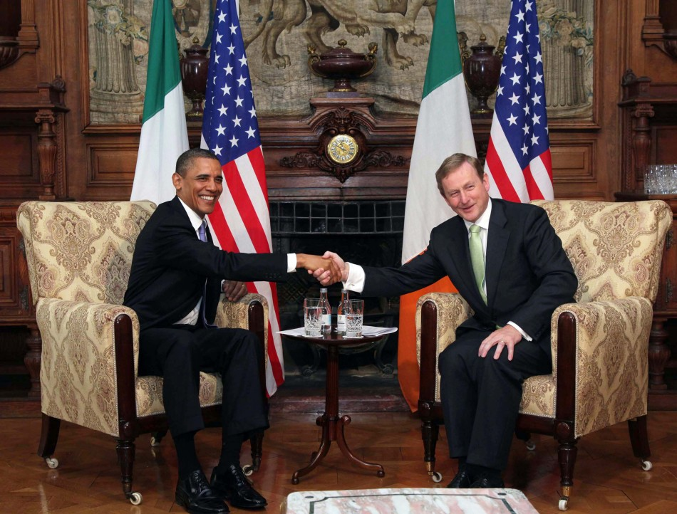 U.S. President Barack Obama poses with Ireland's Prime Minister Enda Kenny during their meeting in Farmleigh near Dublin
