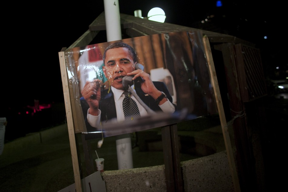 A poster of U.S. President Obama is seen after eggs were thrown at it during an Israeli right wing protest in Tel Aviv