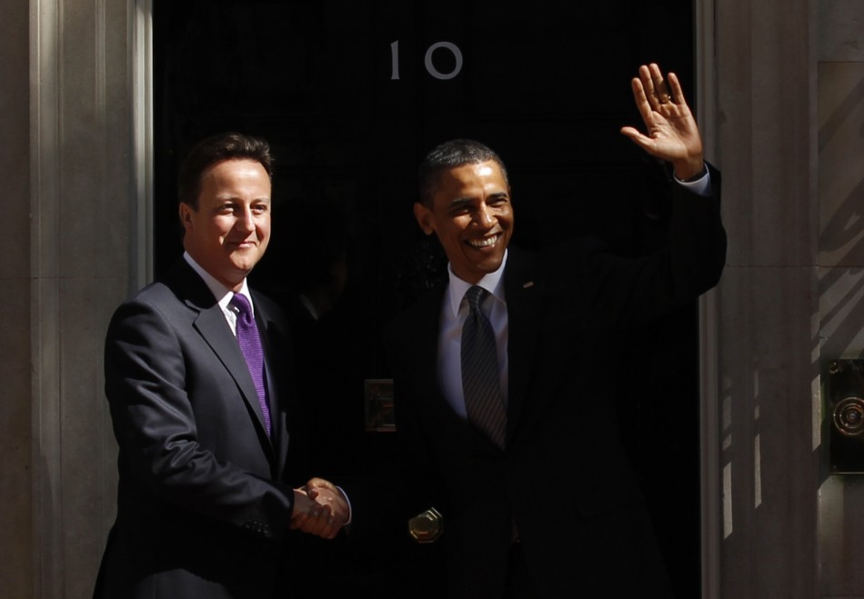 Obama waves as he his greeted by Cameron upon arrival at 10 Downing Street