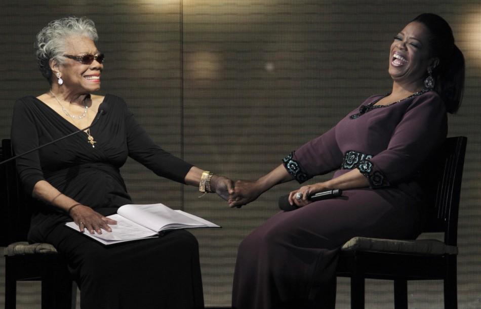 Oprah Winfrey (R) laughs with poet Maya Angelou