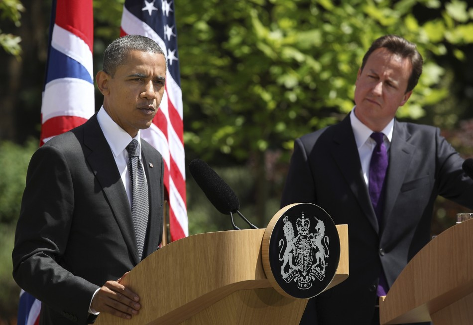 Britain's Prime Minister David Cameron listens as U.S. President Barack Obama speaks during a joint news conference at Lancaster House in London