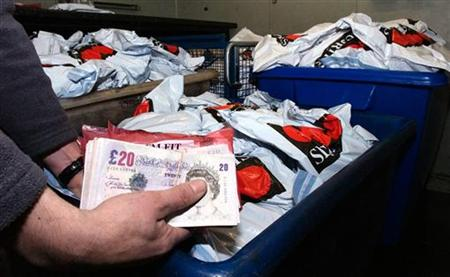 Undated handout photo released by Kent Police shows some of the cash recovered from the robbery of a Securitas depot in Tonbridge