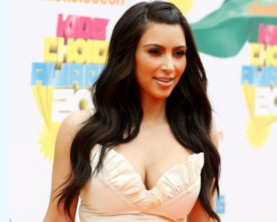 Television personality Kim Kardashian poses at the 2011 Nickelodeon Kids Choice Awards in Los Angeles, California April 2, 2011