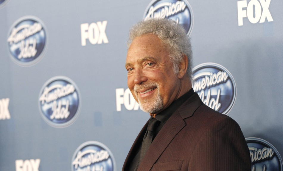 "Singer Tom Jones poses backstage at the finale of the 10th season of ""American Idol"" in Los Angeles May 25, 2011."