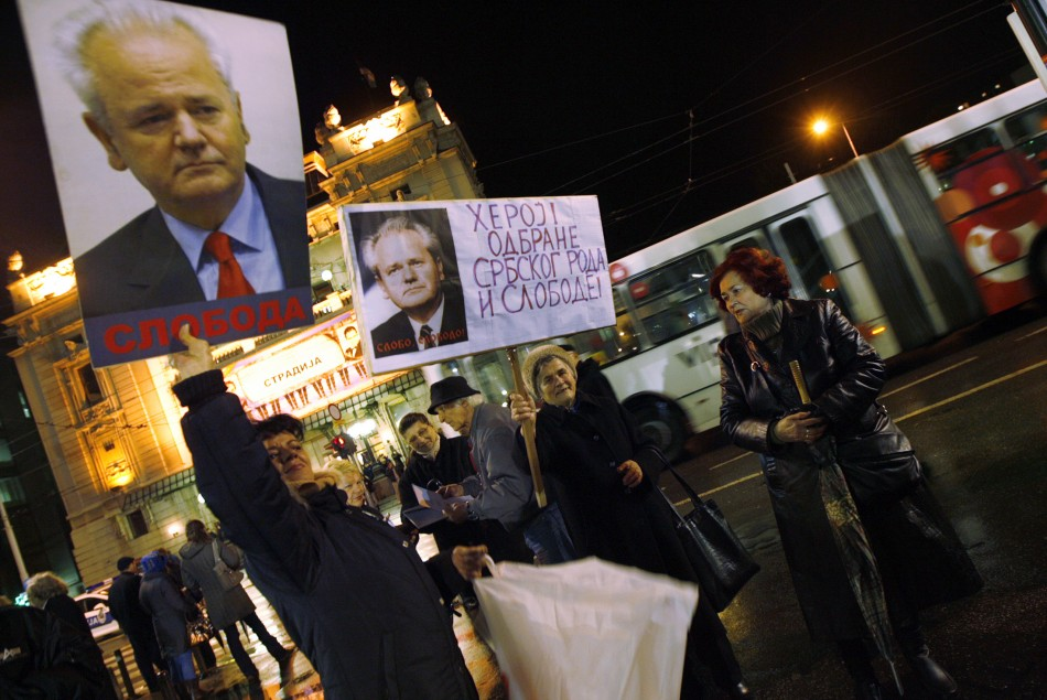 Demonstrators hold placards depicting former Yugoslav President Milosevic during the 10th anniversary of the NATO bombing missions in Yugoslavia, in Belgrade
