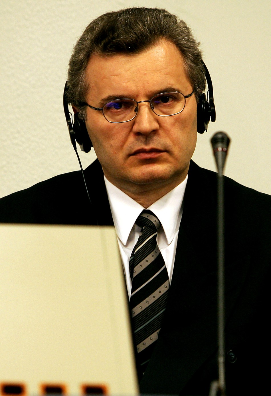 Croatian Serb leader Babic sits in the court room of the ICTY for his appeals judgement in The Hague.
