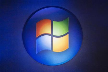 A Windows logo is seen before Microsoft CEO Ballmer speaks about the release of Microsoft's Windows 7 in Toronto