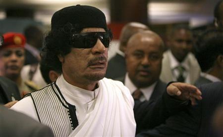 Libyan leader Muammar Gaddafi arrives at the African Union (AU) summit in Addis Ababa