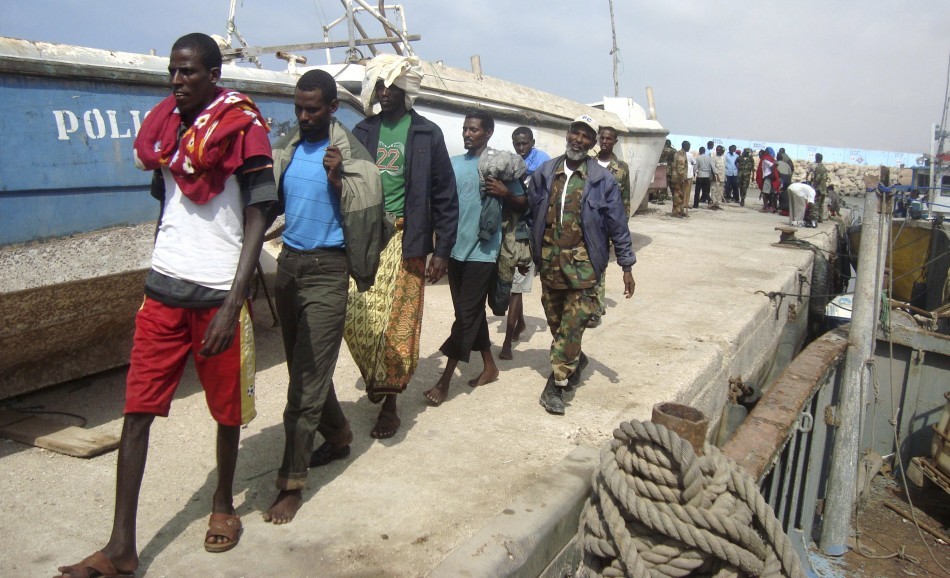 Puntland Marine Forces escort suspected Somali pirates captured by French forces in the Gulf of Aden, at the northern port town of Bosasso