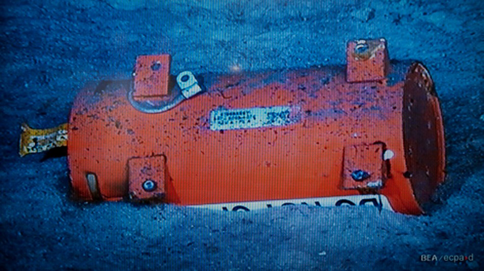 Air France Flight 447's flight data recorder, half-buried in sand