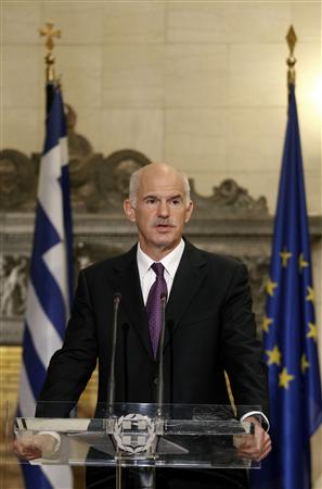 Greece's PM Papandreou addresses reporters during a news briefing at the Maximos mansion in Athens