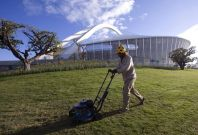 A gardener mows the grass at the Moses Mabhida Stadium in Durban