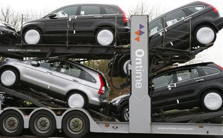A new car transporter leaves the Honda manufacturing plant in Swindon