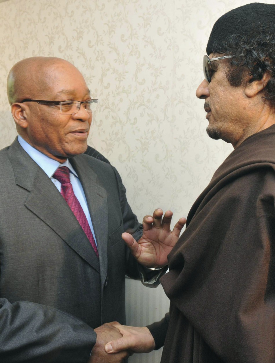 South Africa's President Jacob Zuma greets Libyan leader Muammar Gaddafi before their meeting in Tripoli