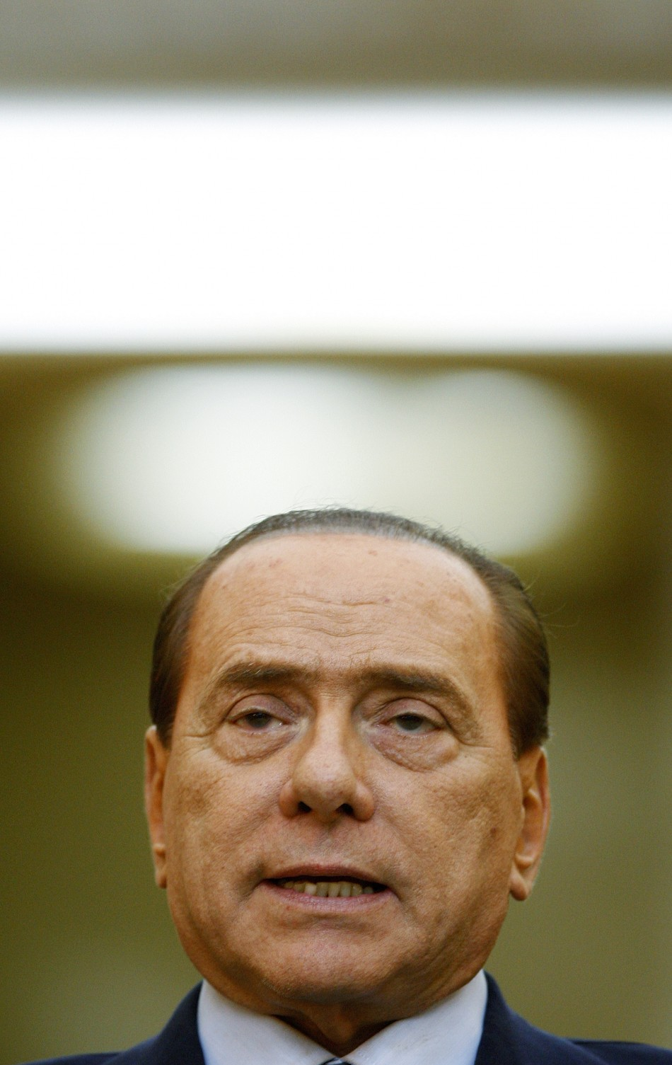 taly's Prime Minister Berlusconi addresses the media during a joint news conference with Romania's Prime Minister Boc at Victoria Palace in Bucharest