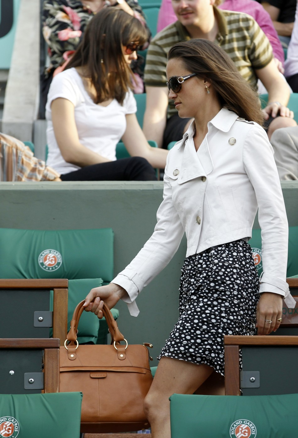 Pippa Middleton, sister of Catherine, Britain's Duchess of Cambridge, leaves the Philippe Chartrier central court during the French Open tennis tournament at the Roland Garros stadium in Paris May 30, 2011.