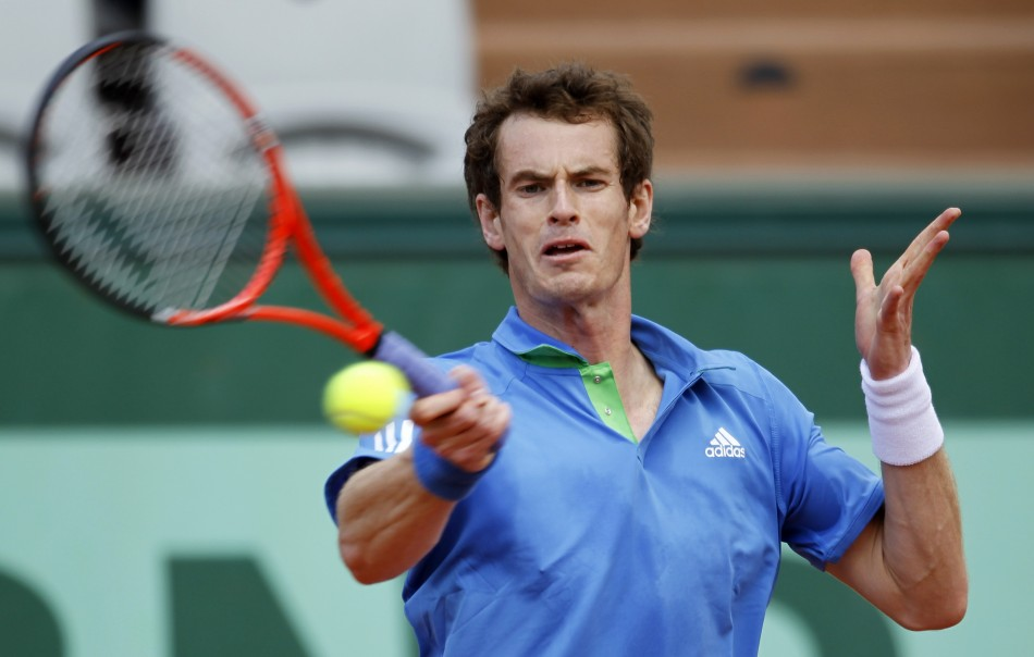Andy Murray of Britain returns the ball to Viktor Troicki of Serbia during the French Open tennis tournament at the Roland Garros stadium in Paris