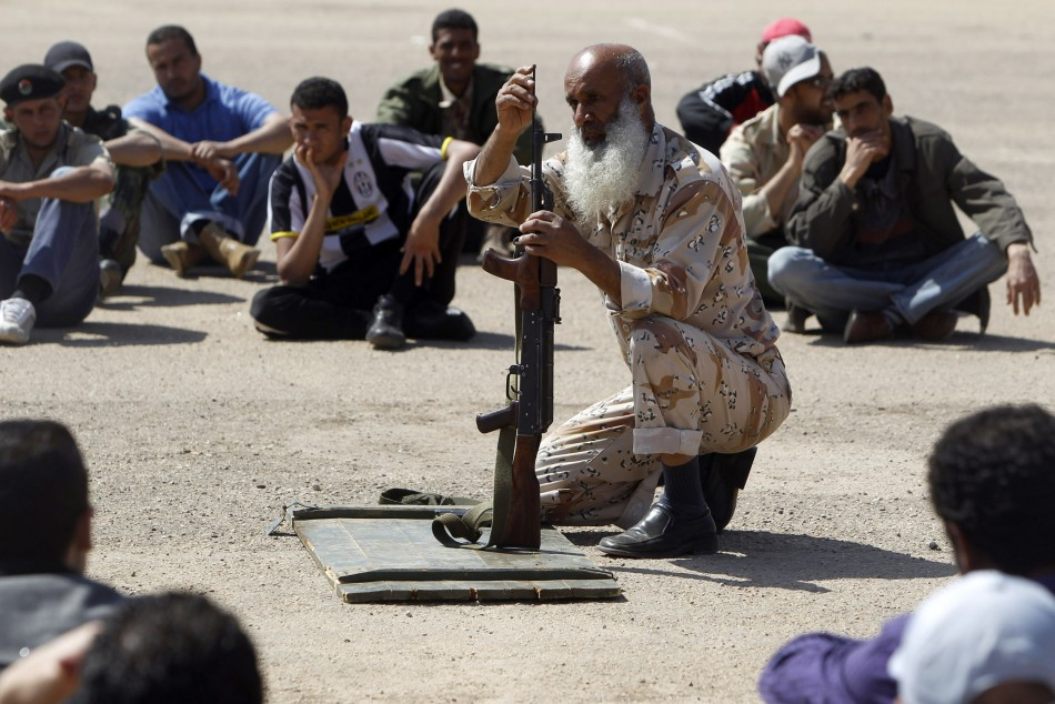 Volunteer fighter listens to an instructor in Benghazi April 13