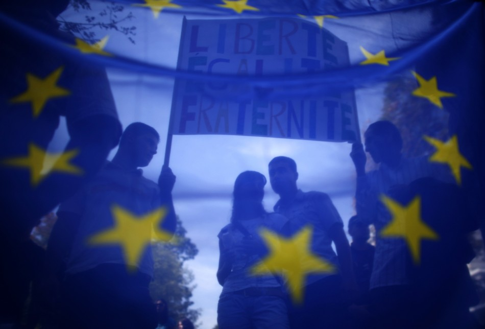 Supporters and members of Bulgarias Roma community are seen through European Union flag during a protest in front of the French embassy in Sofia