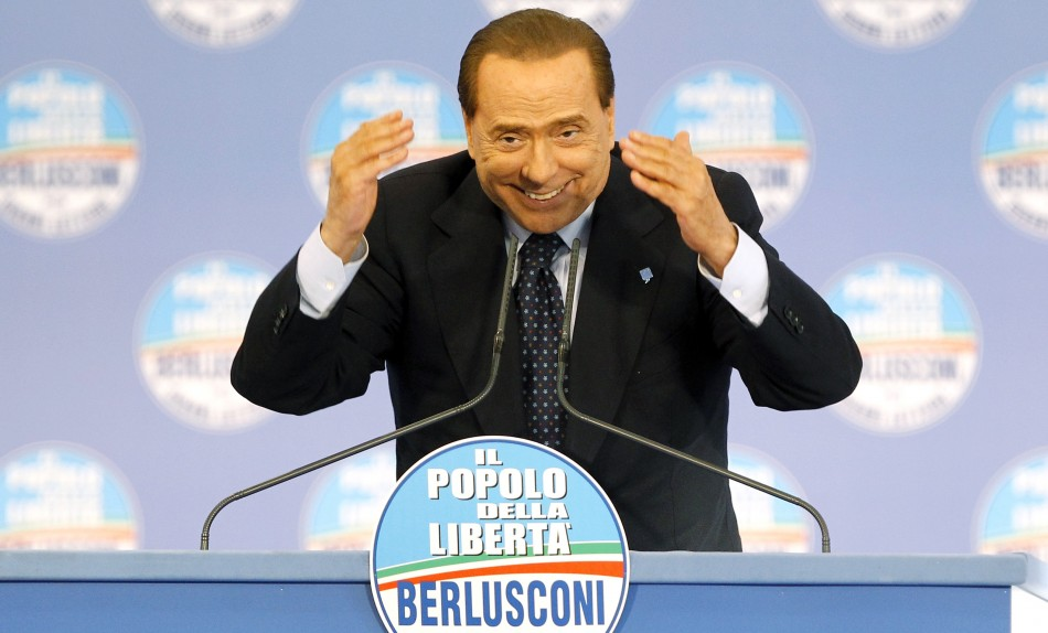 Silvio Berlusconi gestures during a party meeting to support Naple's mayoral candidate, Gianni Lettieri, in Naples