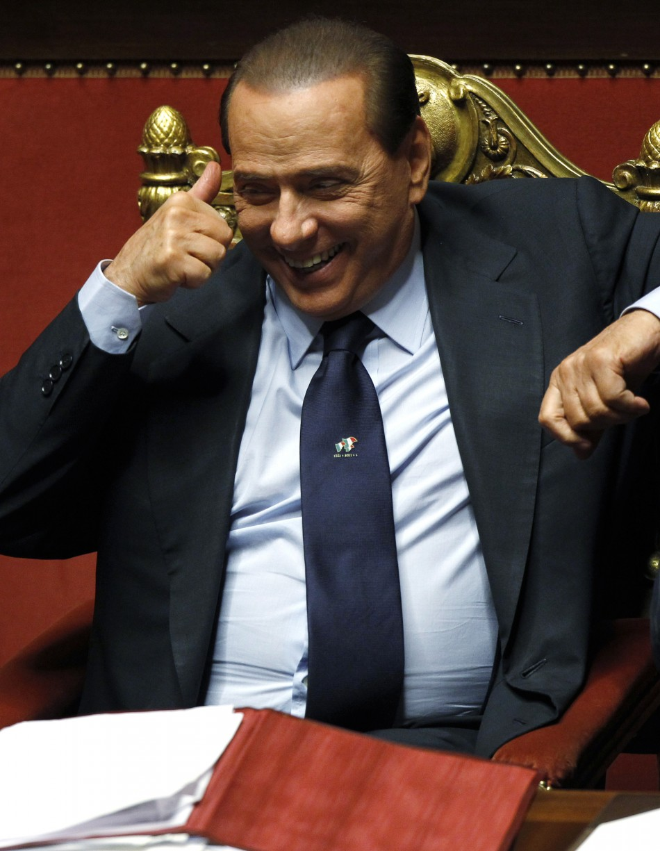 Italian Prime Minister Silvio Berlusconi gives thumbs-up at the Senate in Rome