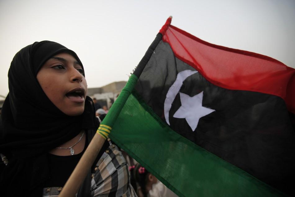 a women chant a slogan during a small demonstration against Libyan Leader Muammar Gaddafi
