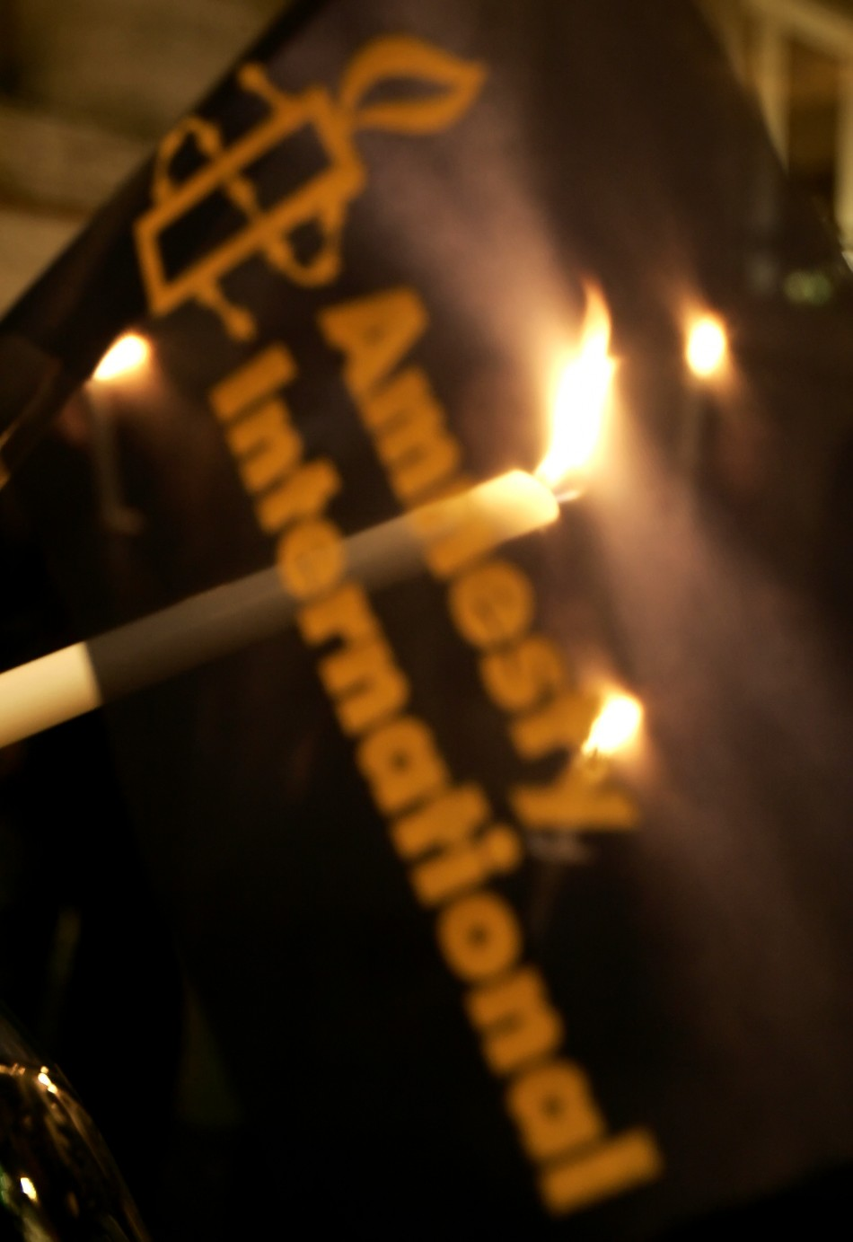 Amnesty International activists hold candles during protest against death penalty in front of US embassy in Rome