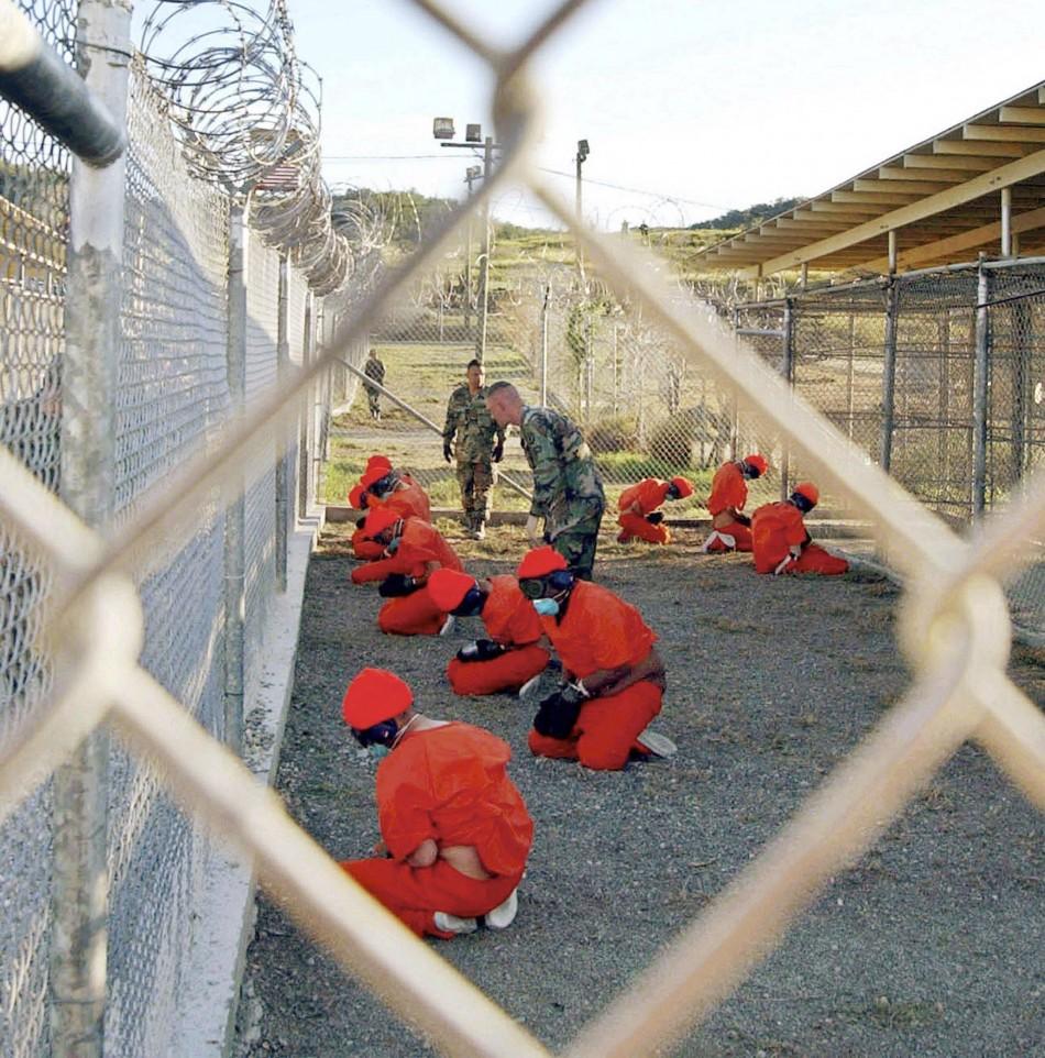 File photo of detainees sitting at Naval Base Guantanamo Bay