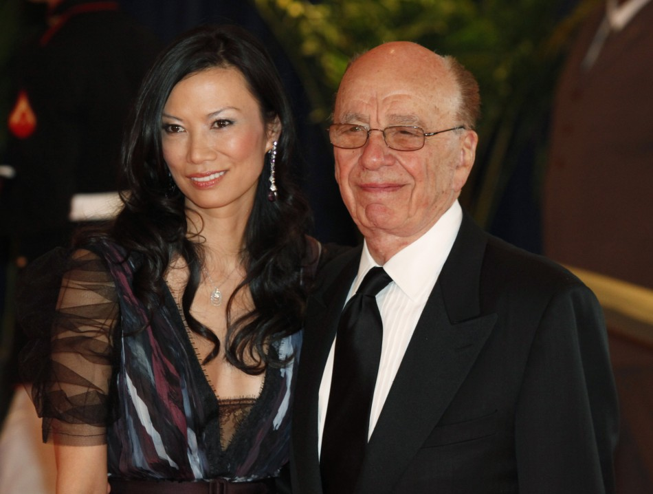 News Corp's Chief Executive Murdoch and his wife arrive at the White House Correspondents' Association dinner in Washington