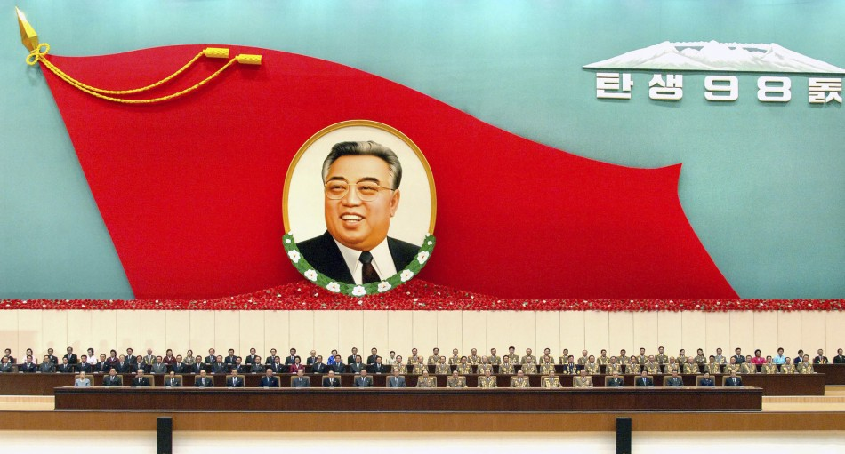 North Korean officials attend a national meeting to commemorate the 98th birth anniversary of North Korean founder and the late leader Kim Il-sung