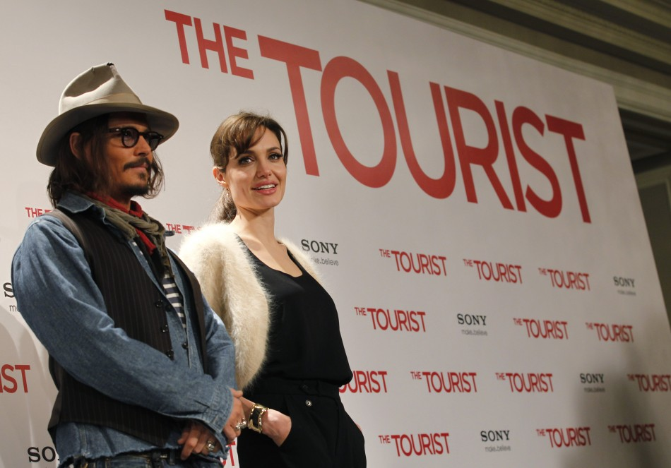 "U.S. actors Angelina Jolie (R) and Johnny Depp pose for pictures during a photocall promoting their movie ""The Tourist"" in Madrid"