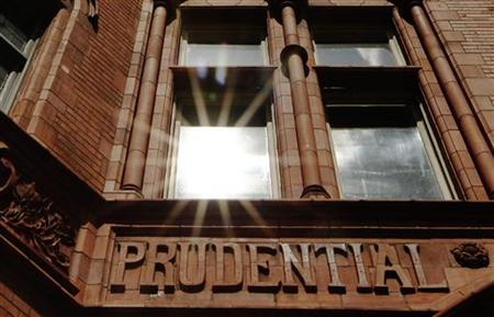 The sun reflects in a window above the raised lettering of the former Prudential Assurance building in the City of London