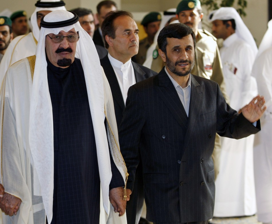 Iran's President Ahmadinejad walks hand-in-hand with Saudi Arabia King Abdullah as they arrive for the opening of GCC summit in Doha