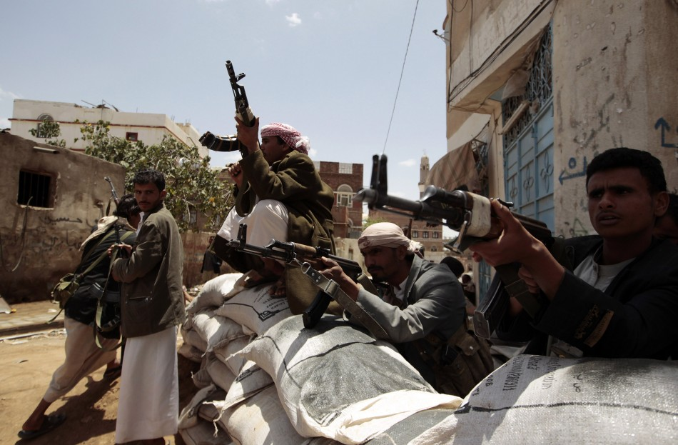 Tribesmen loyal to tribal leader Sadeq al-Ahmar secure a street near al-Ahmar's house in Sanaa