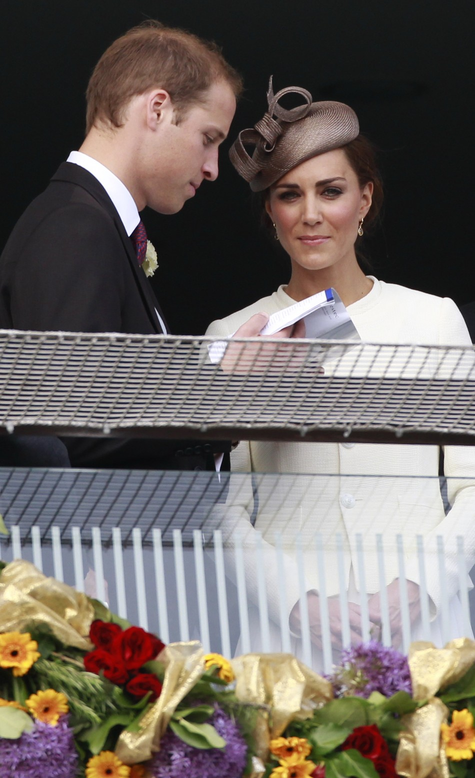 Britain039s Prince William and Catherine, Duchess of Cambridge, watch the racecourse after Queen Elizabeth039s horse Carlton House lost the Epsom Derby at Epsom Racecourse in southern England