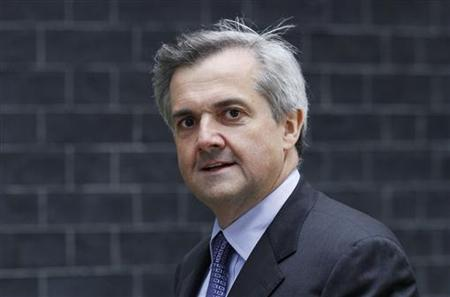 Energy and Climate Change Secretary Huhne arrives at the 10 Downing Street official residence of Prime Minister Cameron in London