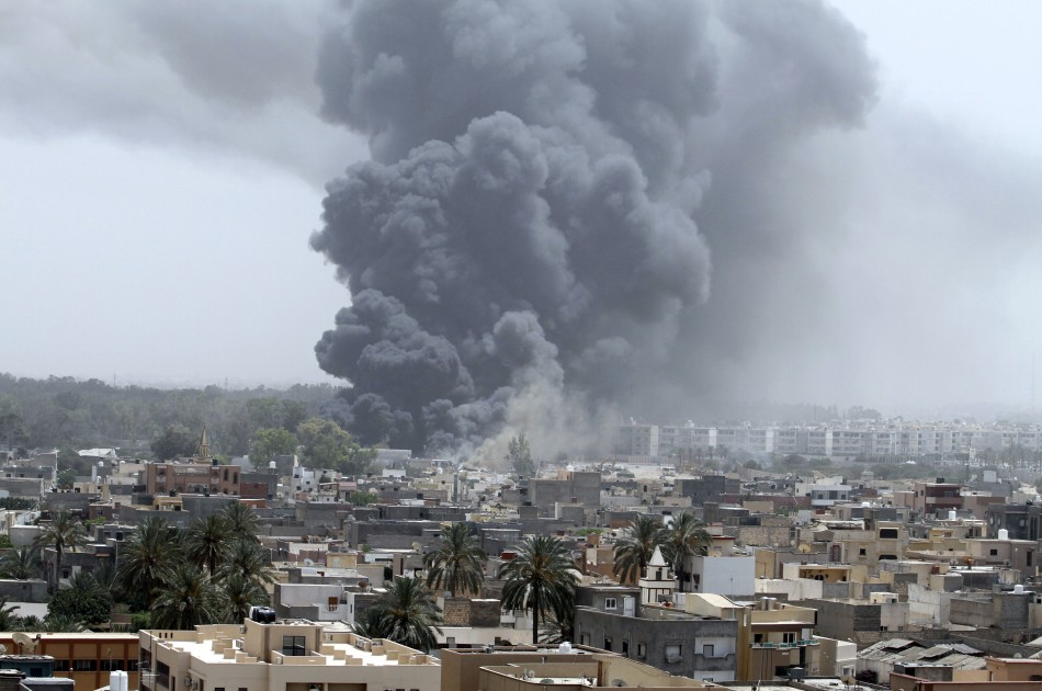 Smoke rises after coalition air strikes in Tripoli