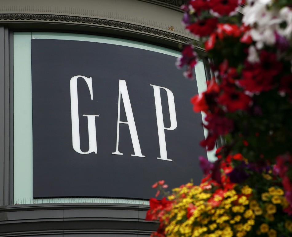A basket of flowers hangs near Gap Inc's flagship retail store at the Powell Street cable car turn in San Francisco