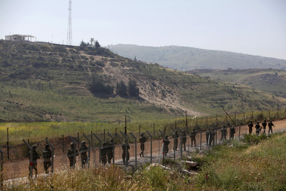 Israeli soldiers patrol along the Israeli-Syrian border near Majdal Shams in the Golan Heights